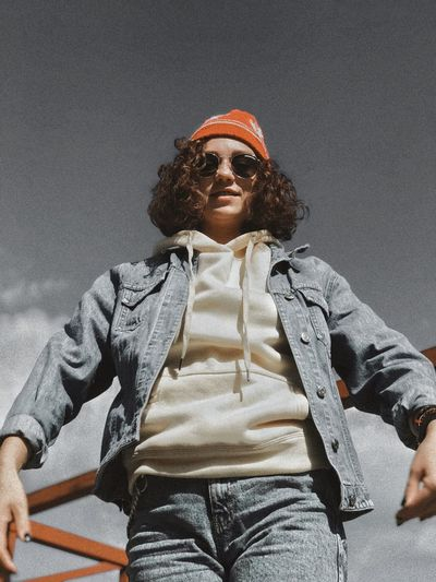 Low angle view of man sitting in sunglasses