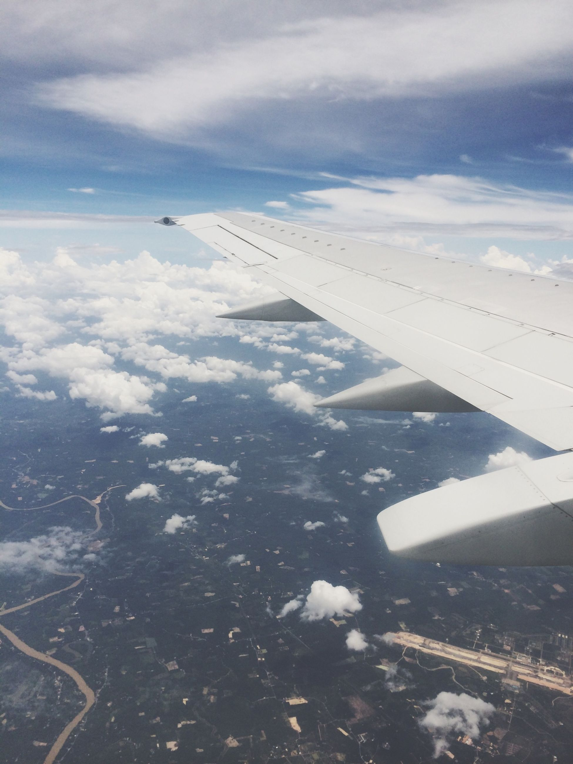 airplane, aircraft wing, air vehicle, flying, transportation, aerial view, mode of transport, sky, mid-air, part of, cropped, landscape, cloud - sky, public transportation, travel, on the move, airplane wing, journey, scenics, nature