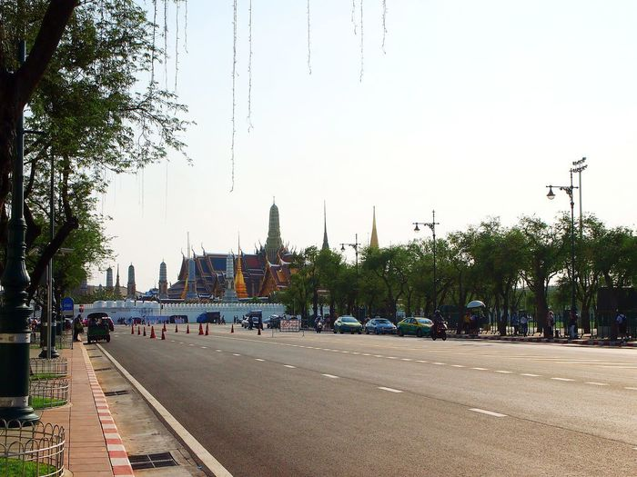 the road way to Grand Palace, Bangkok Grand Palace Cityscape Landmark Bangkok Thailand ASIA Daylight Temple Architecture City Tree Road Street Car Sky Architecture Building Exterior