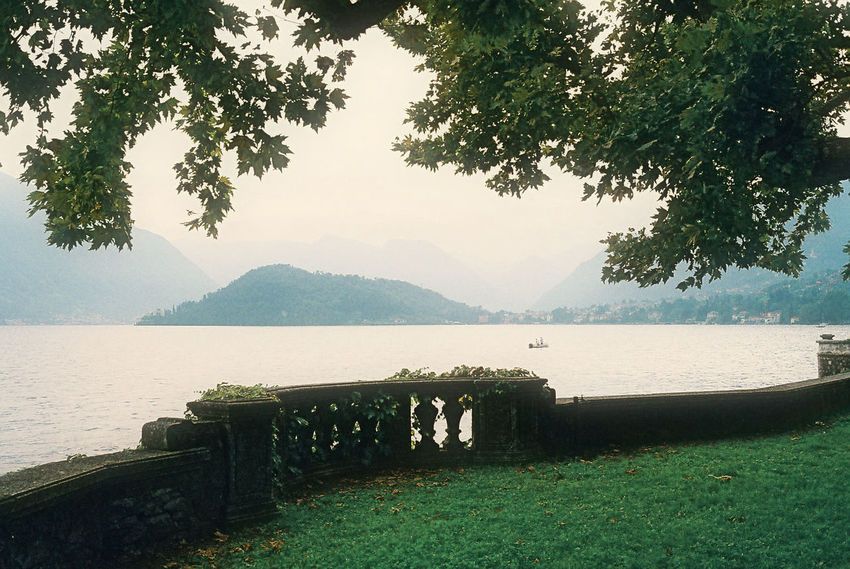 Beauty In Nature Bench Comer See Day Fence Grass Idyllic Lake Lakeshore Landscape Mountain Mountain Range Nature Non-urban Scene River Scenics Sky Tranquil Scene Tranquility Tree Water