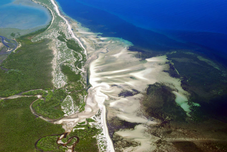 A river spills in to the indian ocean along the coast of tanzania.