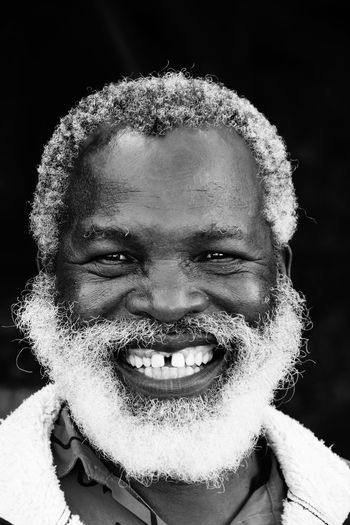 This man sold me some nice HandyCraft in south africa and was so proud to be photographed - I will never forget him Black And White Collection  Black And White Portrait Black Man Close-up EyeEm Best Shots EyeEm Gallery Faces Of EyeEm Monochrome Photography Natural Light Portrait Front View My Year My View Headshot Human Face My Favorite Photo Old Man Portrait Portrait Of A Man  Shades Of Grey Showing Imperfection Smile Tooth Space White Beard Everyday Emotion The Portraitist - 2016 EyeEm Awards Fine Art Photography Welcome To Black EyeEm Diversity Black And White Friday This Is Aging