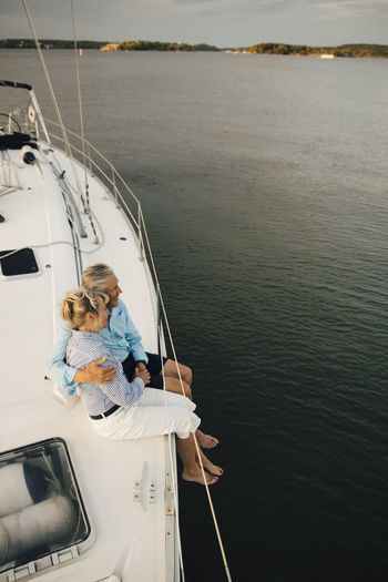 People sitting on boat sailing in sea