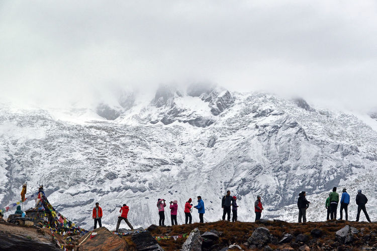 People On Landscape Against Snowcapped Mountain
