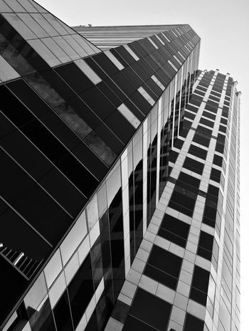 Blackandwhite Architecture Minimalism Building Exterior Modern Built Structure City Façade Window Reflection Skyscraper Business Corporate Business No People Day Outdoors Futuristic Sky Rethink Things Black And White Friday The Graphic City Visual Creativity The Architect - 2018 EyeEm Awards The Great Outdoors - 2018 EyeEm Awards The Traveler - 2018 EyeEm Awards The Creative - 2018 EyeEm Awards