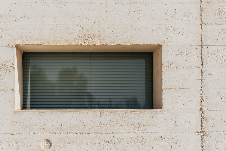 Exterior Of Building With Window During Sunny Day