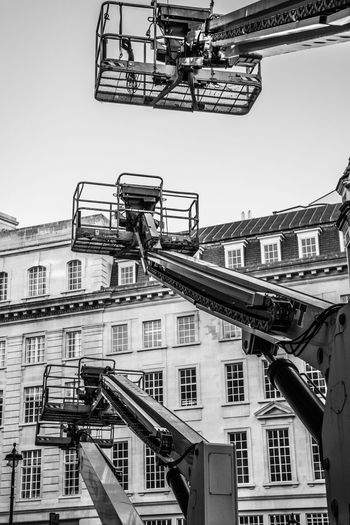 Black And White London Many Cherry Pickers Cherry Pickers On London Street Crane In London Cherry Picker Built Structure Architecture Building Exterior Sky City Nature Day Construction Industry Construction Site Clear Sky Building Low Angle View Outdoors Machinery