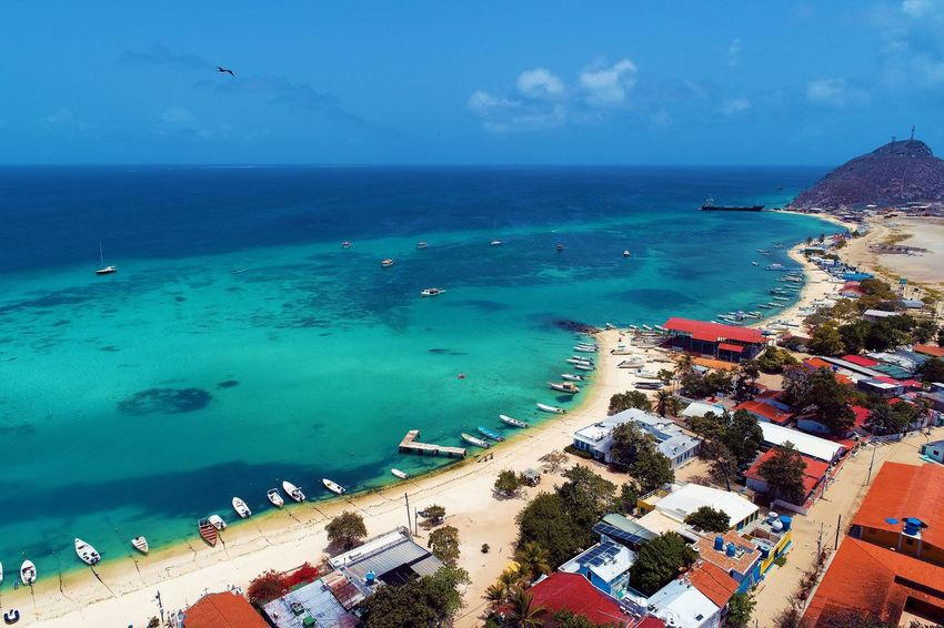 Aerial view of island and beach in Los Roques, Venezuela Sea Water Horizon Over Water Horizon Beach Sky Land Nature Scenics - Nature Blue Day High Angle View Beauty In Nature Travel Destinations Tropical Climate Tranquil Scene Outdoors Turquoise Colored Building Exterior No People Los Roques Madrisqui Caribe Caribbean Caribbean Life Caribbean Island Francisqui Crasqui Carenero's Beach Cayo De Agua Venezuela