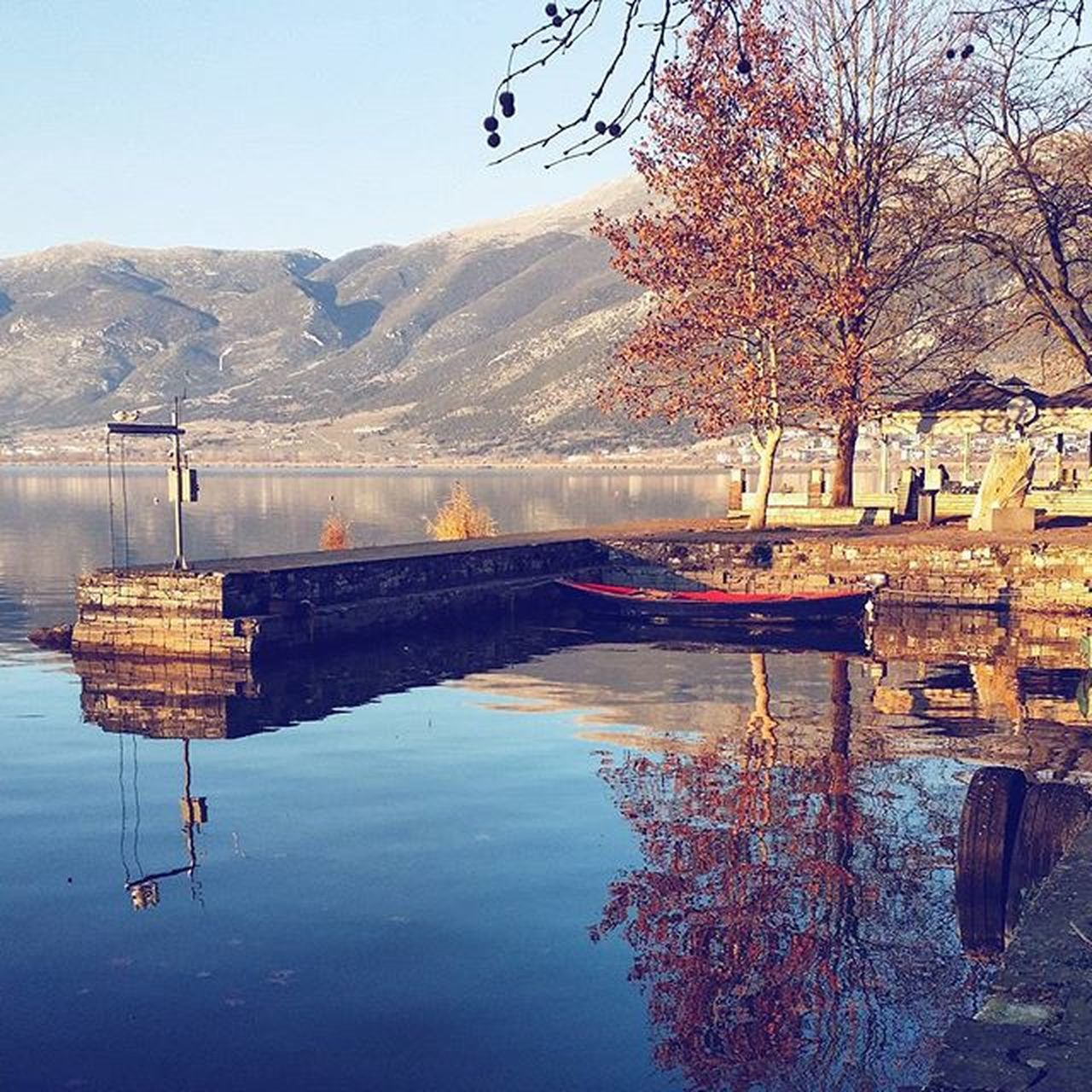mountain, water, reflection, nature, outdoors, lake, mountain range, scenics, day, beauty in nature, no people, tranquility, sky, tree, architecture, bare tree, clear sky