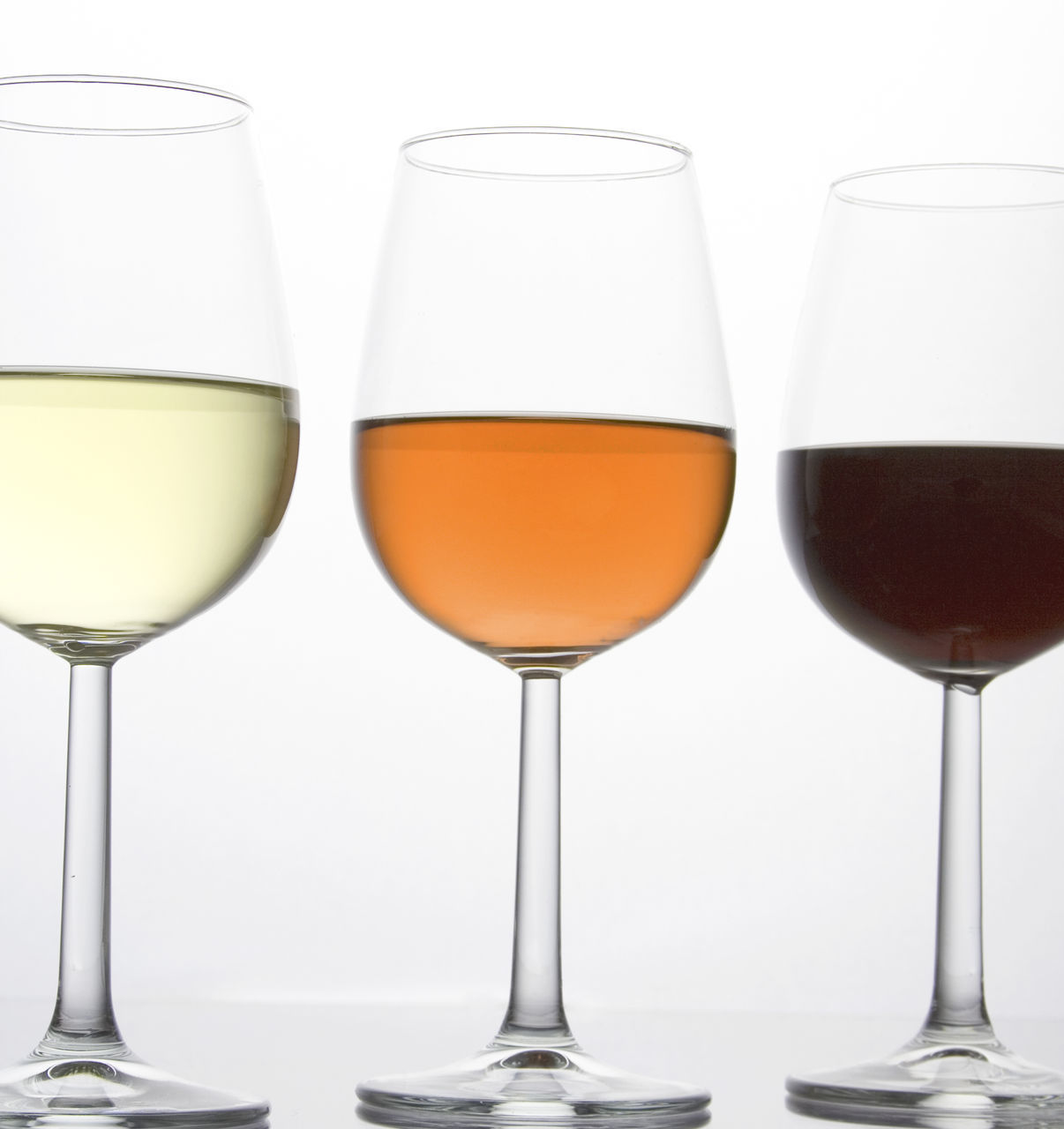 Close-Up Of Drinks Against White Background
