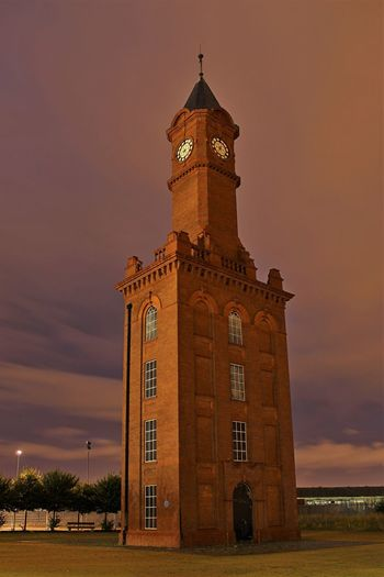 Architecture Building Exterior Built Structure Clock Clock Tower Dock Clock Illuminated Low Angle View Middlesbrough Dock Clock Nature Night No People Outdoors Sky Sunset Tower Travel Destinations