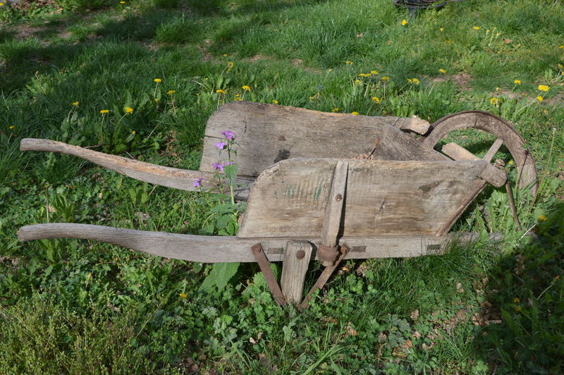 An old wooden wheelbarrow An Old Wooden Wheelbarrow Wheel Wheelbarrow Abandoned Broken Broken Wheelbarrow Garden Grass No People Obsolete Old Old Wheelbarrow Old Wooden Wheelbarrow Outdoors Park Pushcart Very Old Wood - Material Wooden Wheelbarrow