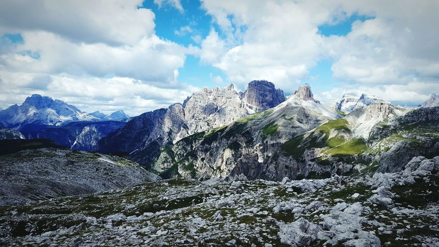 Distant View Of Tre Cime Di Lavaredo Against Cloudy Sky