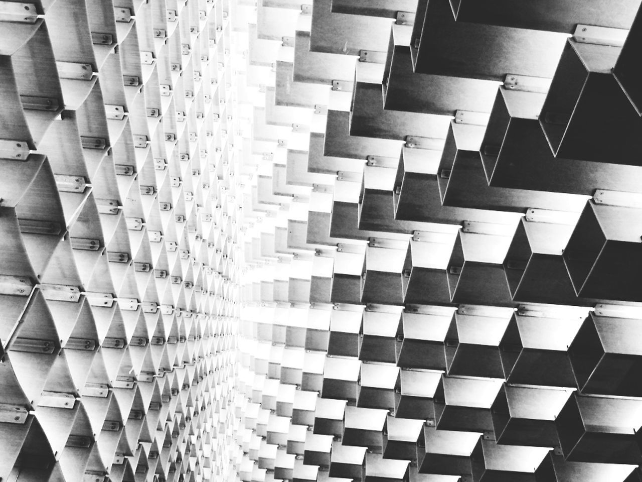 in a row, large group of objects, full frame, indoors, backgrounds, repetition, pattern, arrangement, abundance, no people, close-up, day