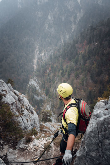 High angle view of climber looking at valley