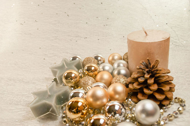 Deocration for christmas season with mix ball in gold with gilter, gol simple, silver ,candle in big size and star form decoration with fruit pine and silver necklace, white background. Candle Christmas Family Flooring Gold Necklaces Background Ball Brilliant Brown Hair Candlelight Close-up Day Decorations No People Outdoors Silver  White