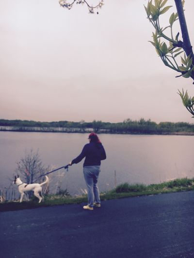 Dogs Of EyeEm Nature Walk Walking Around Woman Dog Full Length One Person Water Real People Rear View Lifestyles Sky Nature Lake Standing Day Casual Clothing Leisure Activity Outdoors