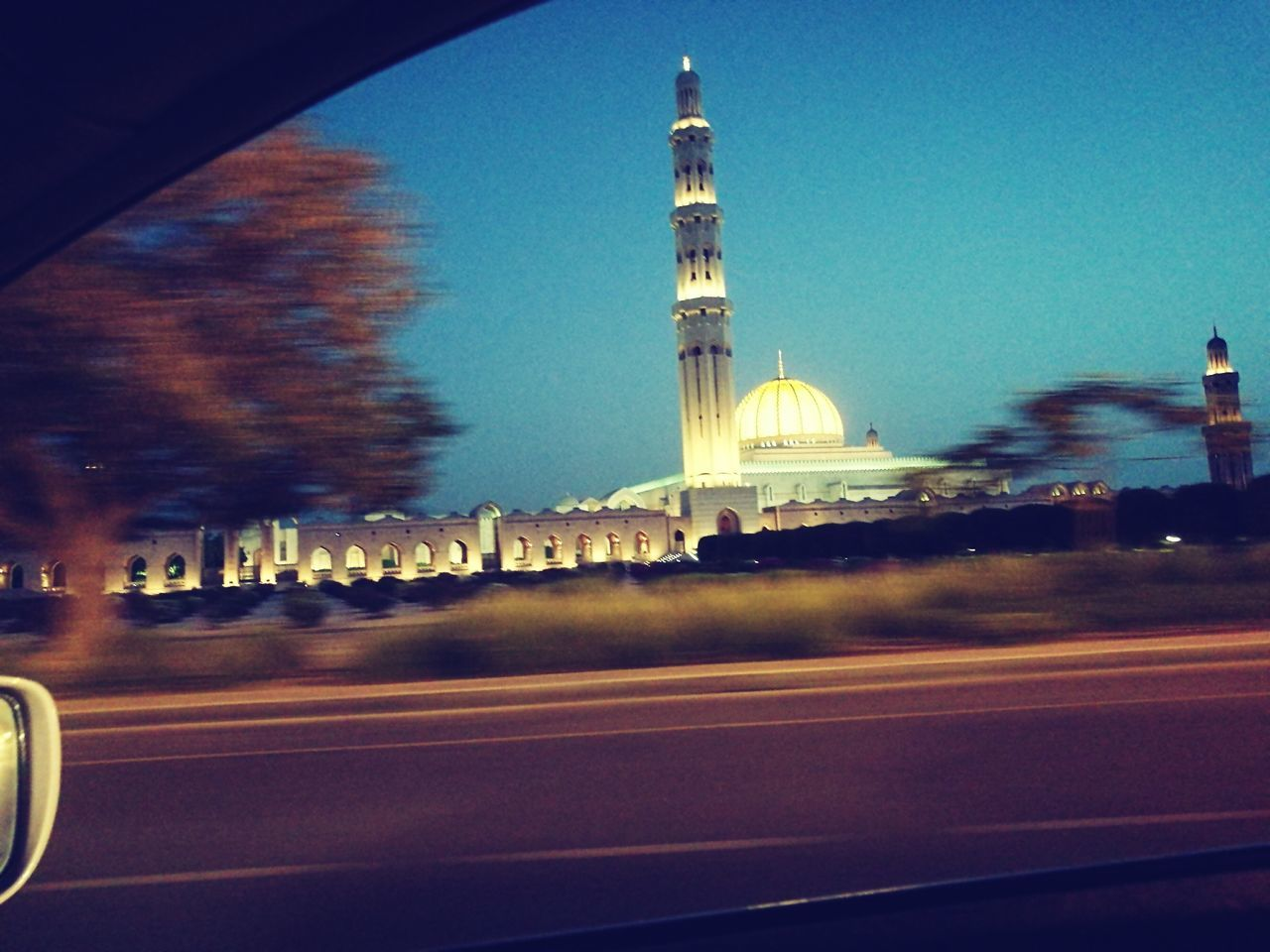 blurred motion, road, transportation, speed, motion, no people, sky, built structure, illuminated, architecture, clear sky, outdoors, day
