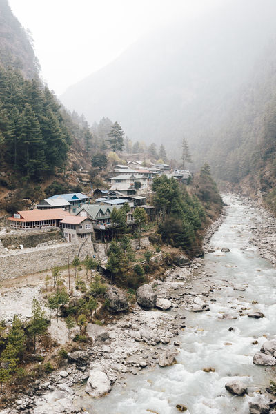 EBC Trek 2018 The Week on EyeEm Architecture Beauty In Nature Building Building Exterior Built Structure Day Environment Fog House Land Landscape Mountain Nature No People Outdoors Plant River Scenics - Nature Sky Tranquil Scene Tree Valley Village Water
