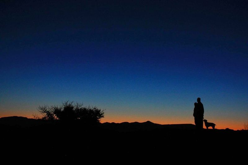 Silhouette Copy Space Blue Clear Sky Standing Sunset Nature Real People Tranquil Scene Outdoors Walking Full Length Landscape Leisure Activity Sky Desert Beauty In Nature Men Moon Mountain Ft Davis TX