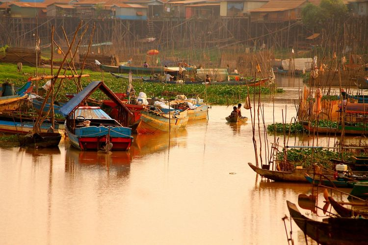 Traditional fishing boats on lake at sunset