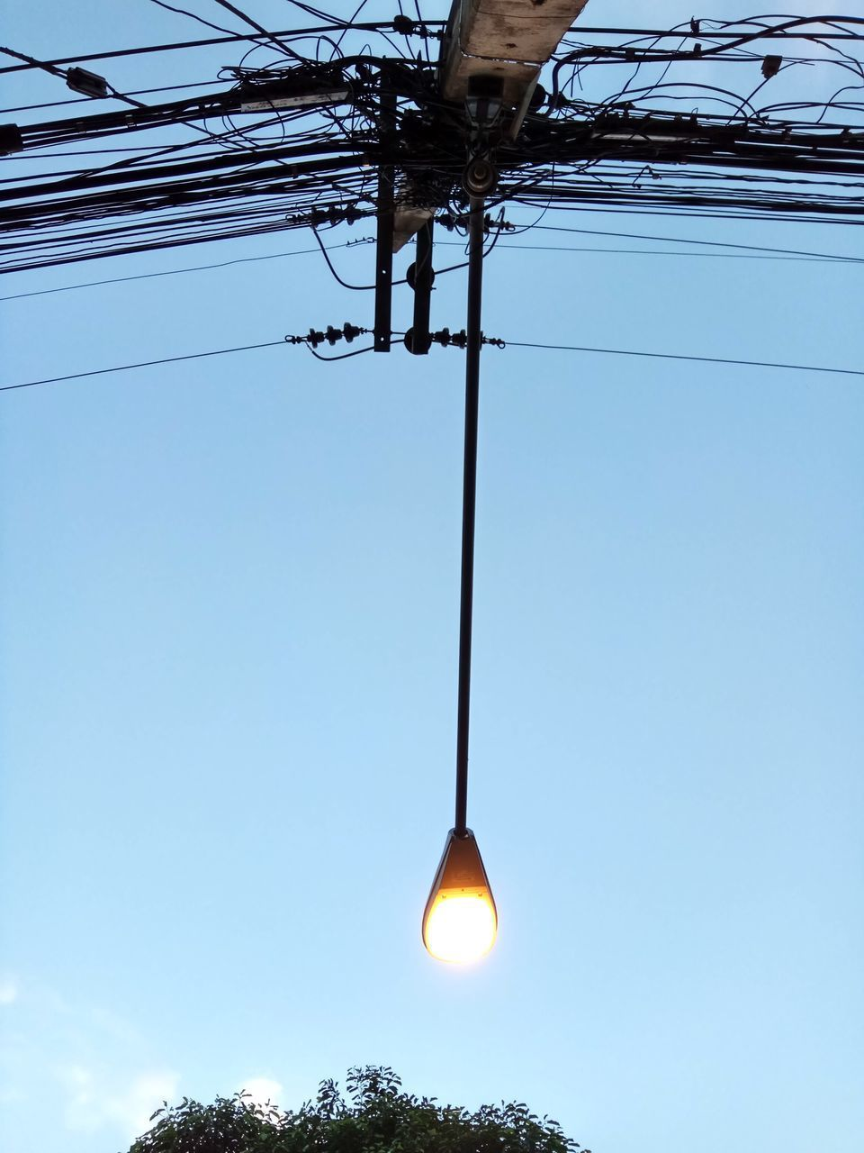 electricity, cable, power line, power supply, low angle view, fuel and power generation, connection, lighting equipment, no people, technology, electricity pylon, outdoors, blue, sky, clear sky, illuminated, day, close-up