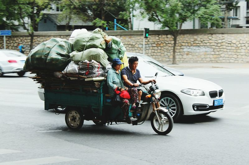 Social Contrast Transportation Mode Of Transport Car Full Length Land Vehicle Day Outdoors Poorpeople Richpeople Beijing China BEIJING北京CHINA中国BEAUTY