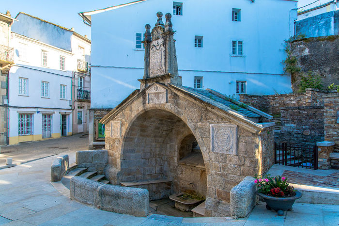 Architectural Feature Architecture Buildings Carved Stones Clean Day Flowers Fountain Galicia, Spain Horizontal Houses Monumental  No People Old Public Stone Street Street Photography Town Urban Water