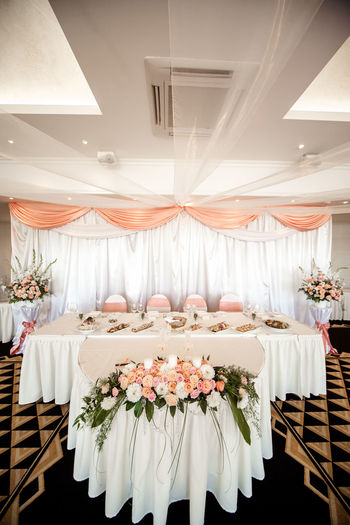 Wedding table setting at restaurant Banquet Romance Table Setting Table Arrangements Wedding Wedding Reception Arrangement Beauty Bouquet Bunch Of Flowers Celebration Event Curtain Decorated Flowers Indoors  No People Nobody Place Setting Restaurant Serving Size Table Tablecloth Wedding Banquet Wedding Chairs Wedding Table