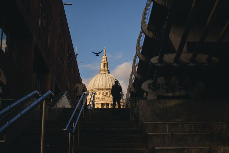 Low angle view of steps leading towards st paul cathedral against sky