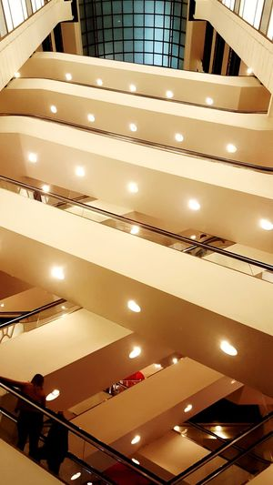 Looking up at escalators Cellphone Photography Chicago View Architecture City Life Built Structure Perspective People Movement Life Floors Crossing Escalators And Steps Store Inside