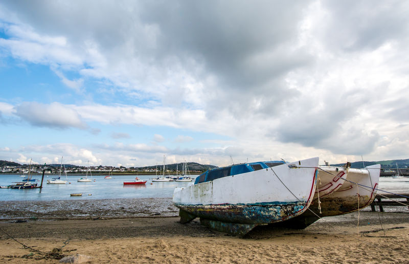 Beach Boat Cloud Cloud - Sky Cloudy Coastline Day EyeEm Best Shots Followme Mode Of Transport Moored Nature Nautical Vessel No People Outdoors Riverbank Sand Sandy Sea Shore Sky Tranquil Scene Tranquility Transportation Water Live For The Story