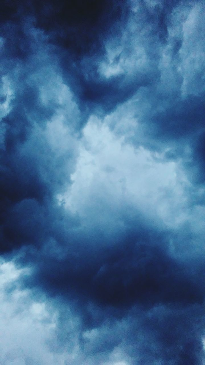 cloud - sky, sky, sky only, low angle view, beauty in nature, nature, cloudscape, scenics, weather, backgrounds, dramatic sky, tranquility, no people, outdoors, blue, storm cloud, awe, full frame, day