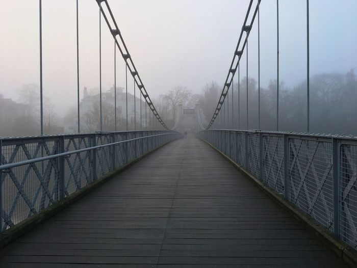 Queens Park Suspension Bridge, Chester Bridge - Man Made Structure Connection Fog The Way Forward Built Structure Engineering Suspension Bridge Railing Outdoors Sky Day Footbridge No People Architecture Nature Morning Cold Foggy Foggy Weather Bridge The City Light