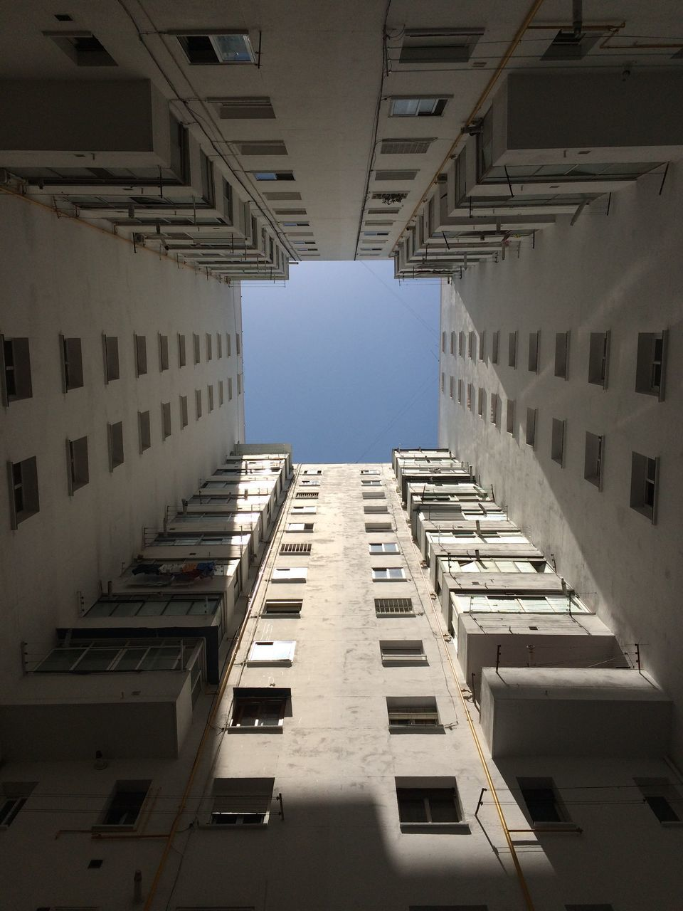 Directly Below View Of Apartment Building Against Sky