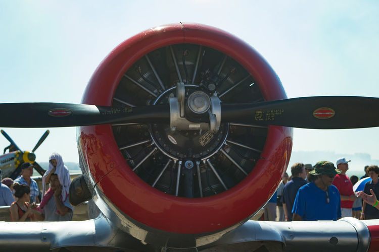 Front view of AT-6 airplane with crowd in the background. Aircraft Engine Airplane AT-6 Propeller Propeller Airplane Radial Engine Transportation WwII Airplane