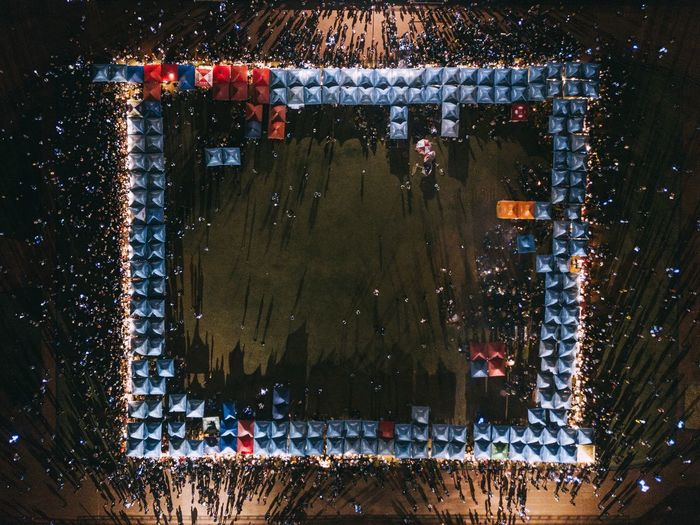 Aerial View Of People At Market In City During Night