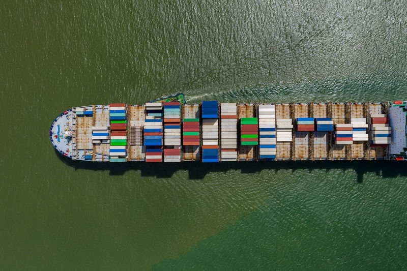 Container ship in export and import business and logistics. shipping cargo to by the sea.