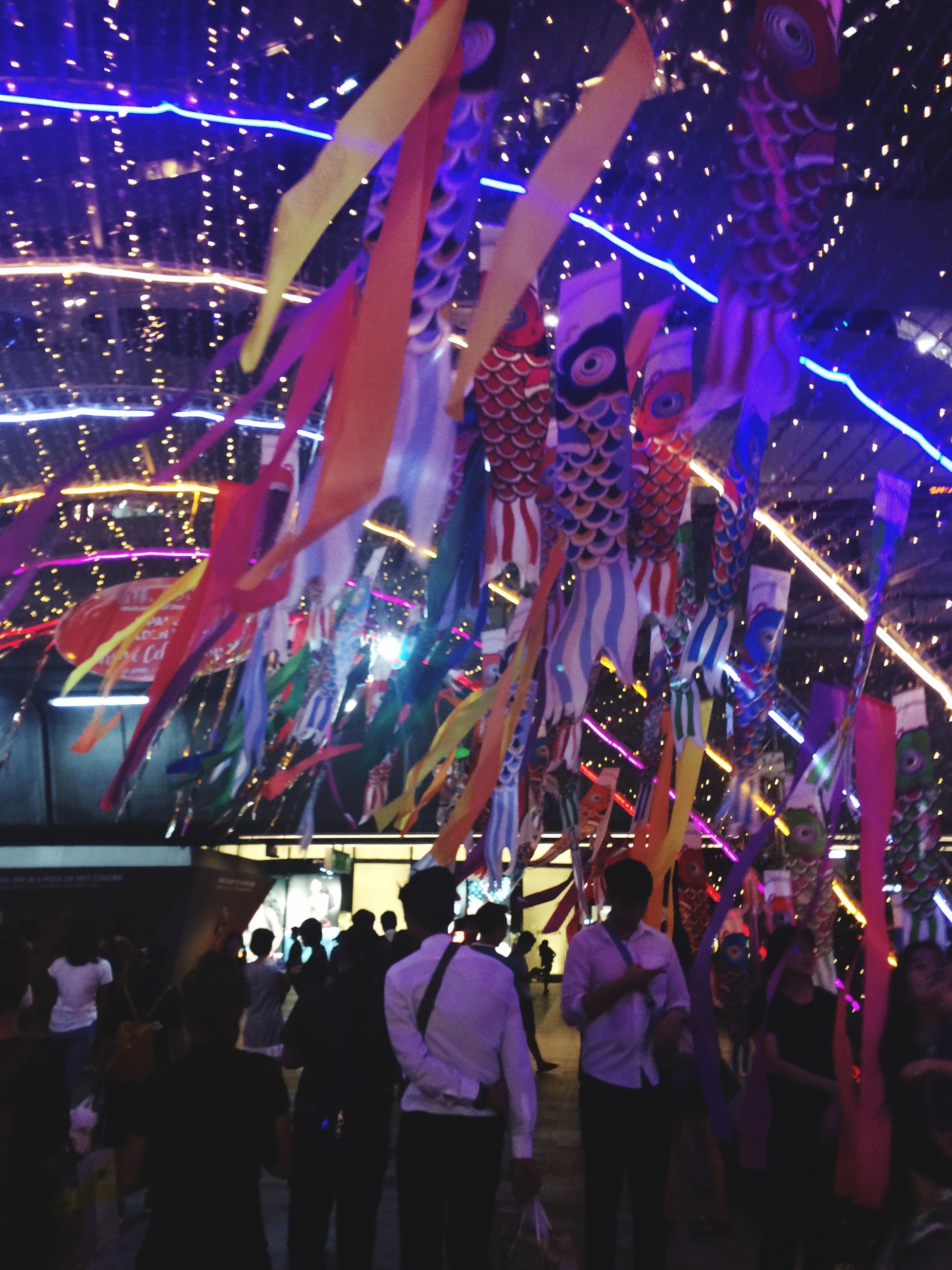 large group of people, illuminated, enjoyment, night, crowd, real people, dancing, music, women, men, celebration, popular music concert, nightlife, excitement, people, performance, audience, event, indoors, fan - enthusiast, adults only, adult, human body part