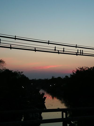 Original Silhouette Water Sunset Reflection No People Lake Sky Outdoors Day Bird Nautical Vessel Nature Beauty In Nature Telephone Line Animal Themes Oil Pump Folk Sunset_collection Sunset Lovers