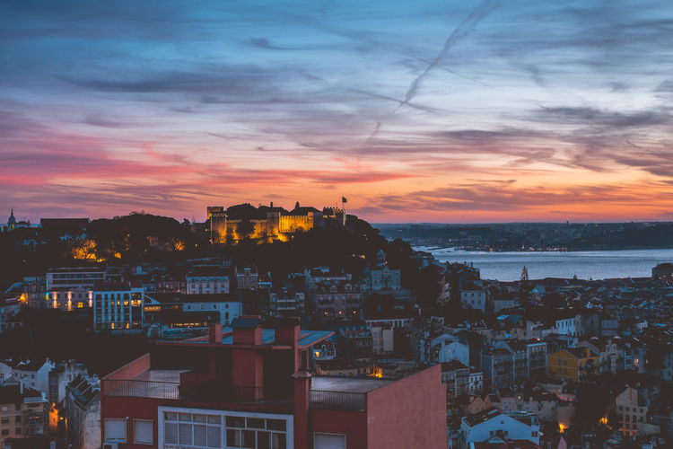 Evening sky over the beautiful town of Lisbon. Architecture Built Structure Travel Destinations Lisbon Portugal Europe Building Exterior Sky Sunset City Cloud - Sky Cityscape Residential District Building Crowd Crowded High Angle View Nature Water Sea Orange Color Outdoors Settlement TOWNSCAPE Romantic Sky