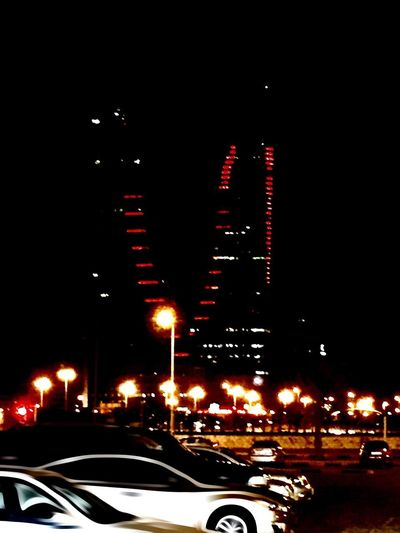 Bahrain Harbor Gate Building Car Illuminated Transportation Night Land Vehicle Mode Of Transport City Building Exterior Traffic Architecture City Life No People Built Structure Road Travel Destinations Outdoors Sky Close-up Beauty In Nature Indoors  Astronomy Nature