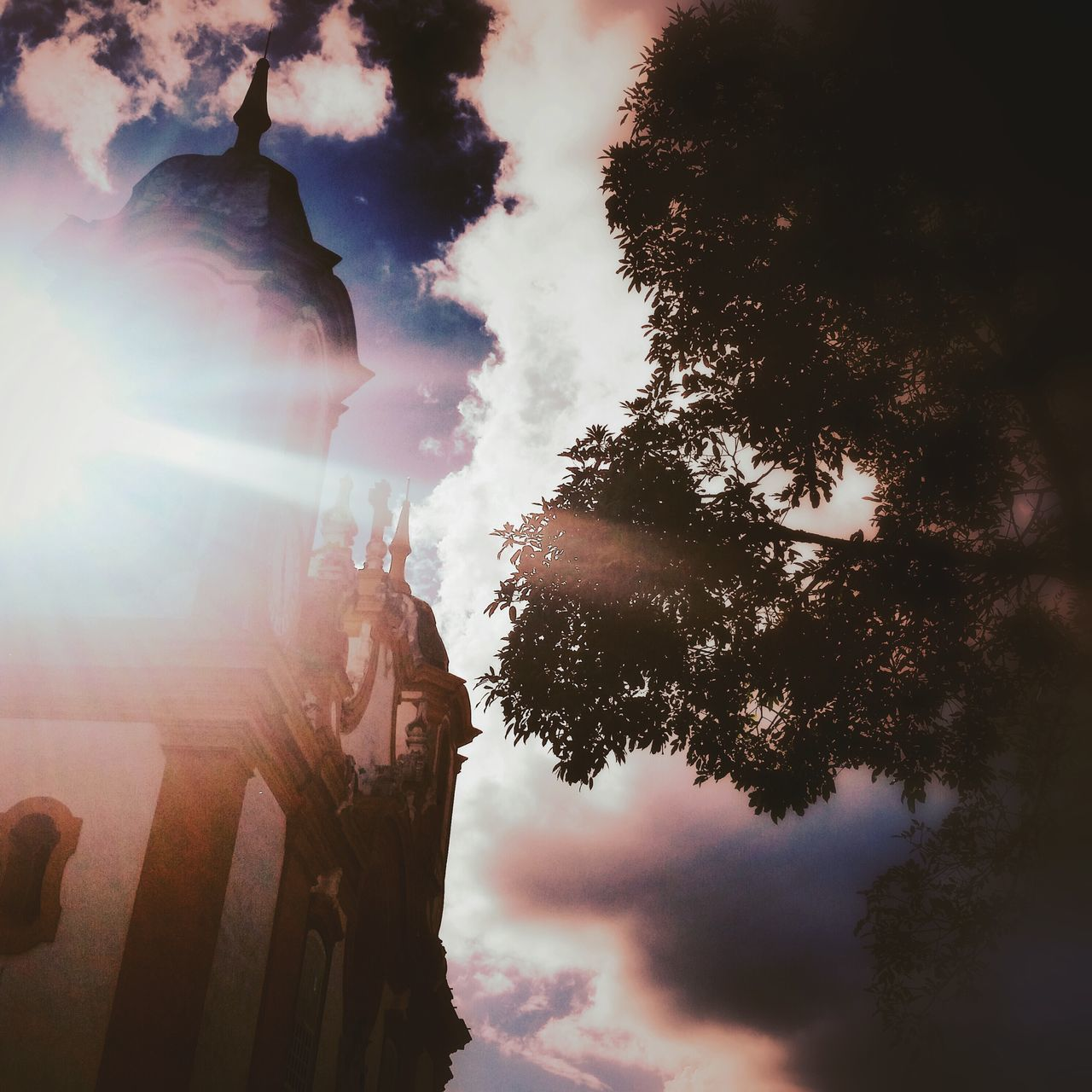 Low Angle View Of Church And Tree Against Cloudy Sky On Sunny Day