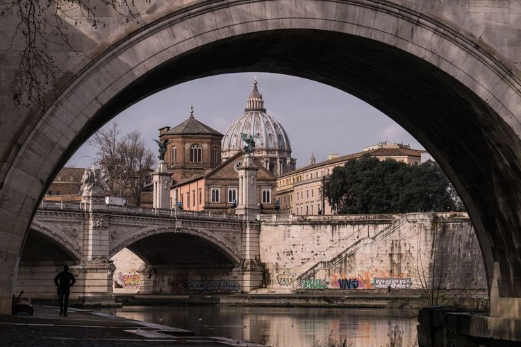 Saint peter basilica seen from arch bridge in city