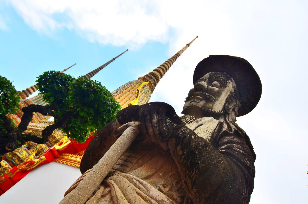 Low angle view of statue against built structure