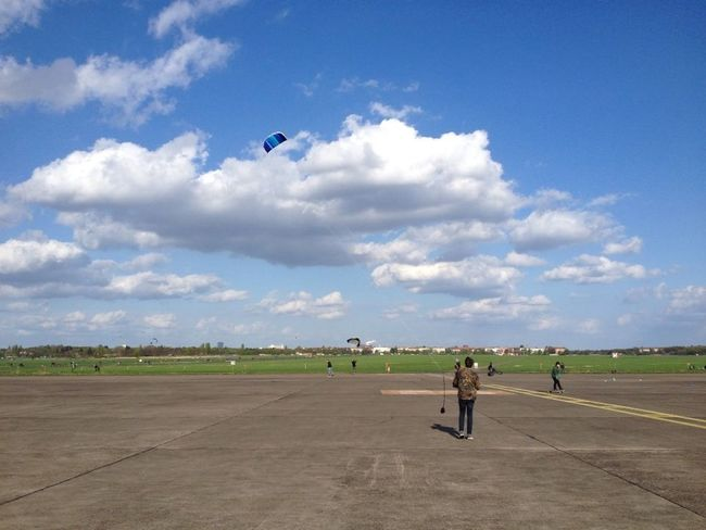 The former airport Tempelhof in Berlin is an exceptional place. 'Tempelhofer Freiheit' is what people experience cruising accross the over 360 ha fast area. Some call it magic. Berlin Tempelhofer Feld Airfield Tempelhof Cloud - Sky Clouds And Sky Leisure Activity One Person Sky