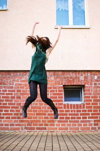 Full length of a jumping girl
