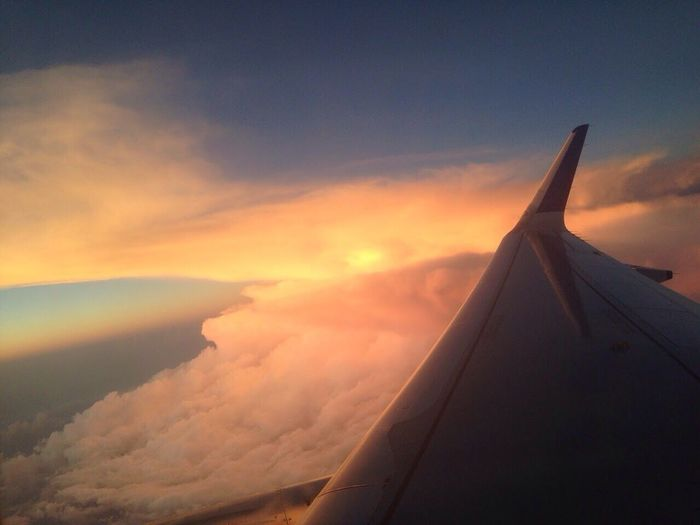 Airplane Sky Cloud - Sky Sunset Journey Aerial View Flying Air Vehicle Aircraft Wing Airplane Wing No People Nature Scenics Beauty In Nature Travel Transportation Outdoors Day
