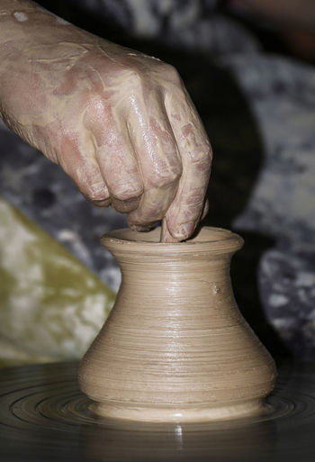 Art And Craft Ceramics Ceramics Studio Clay Craft Craftsperson Creativity Expertise Finger Hand Human Body Part Human Hand Indoors  Making Molding A Shape Occupation One Person Potter's Wheel Pottery Preparation  Real People Skill  Spinning Working