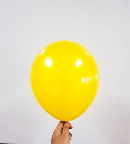Human Body Part Human Hand One Person Yellow Holding Balloon People Personal Perspective Studio Shot Real People Adult Food And Drink Adults Only One Man Only Only Men Close-up Food Healthy Eating Indoors  White Background Balloon Glow BALLOON! Clean Yellow Minimalism Paint The Town Yellow EyeEmNewHere